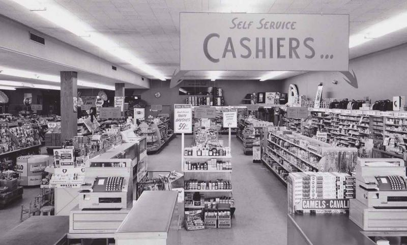 50s-bw-photo-store-self-serve-cashiers-sign